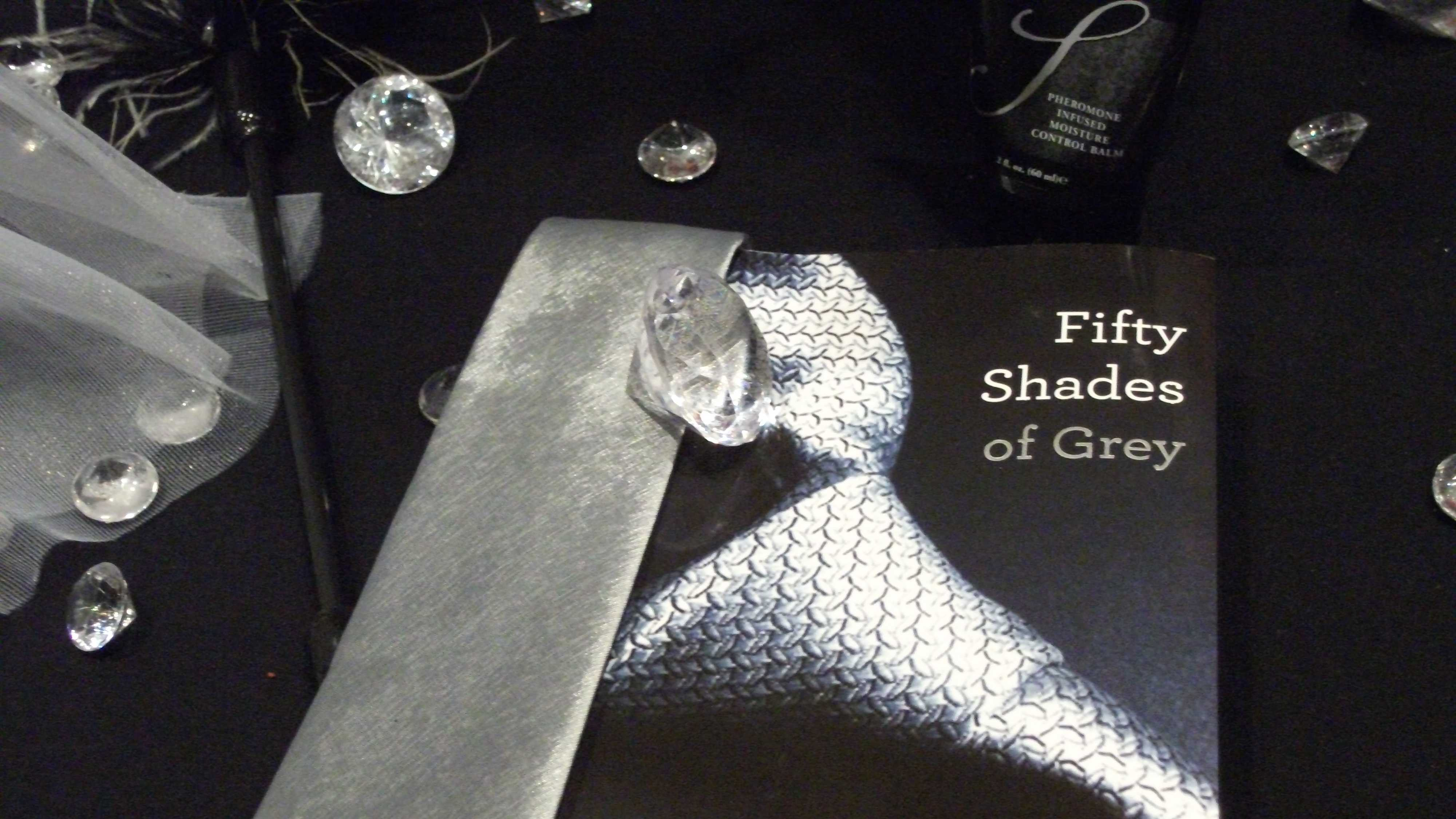 Slumber Parties had their table decorated with the novel, diamonds, ties and feathers which would be great for the 50 Shades of Grey wedding theme.