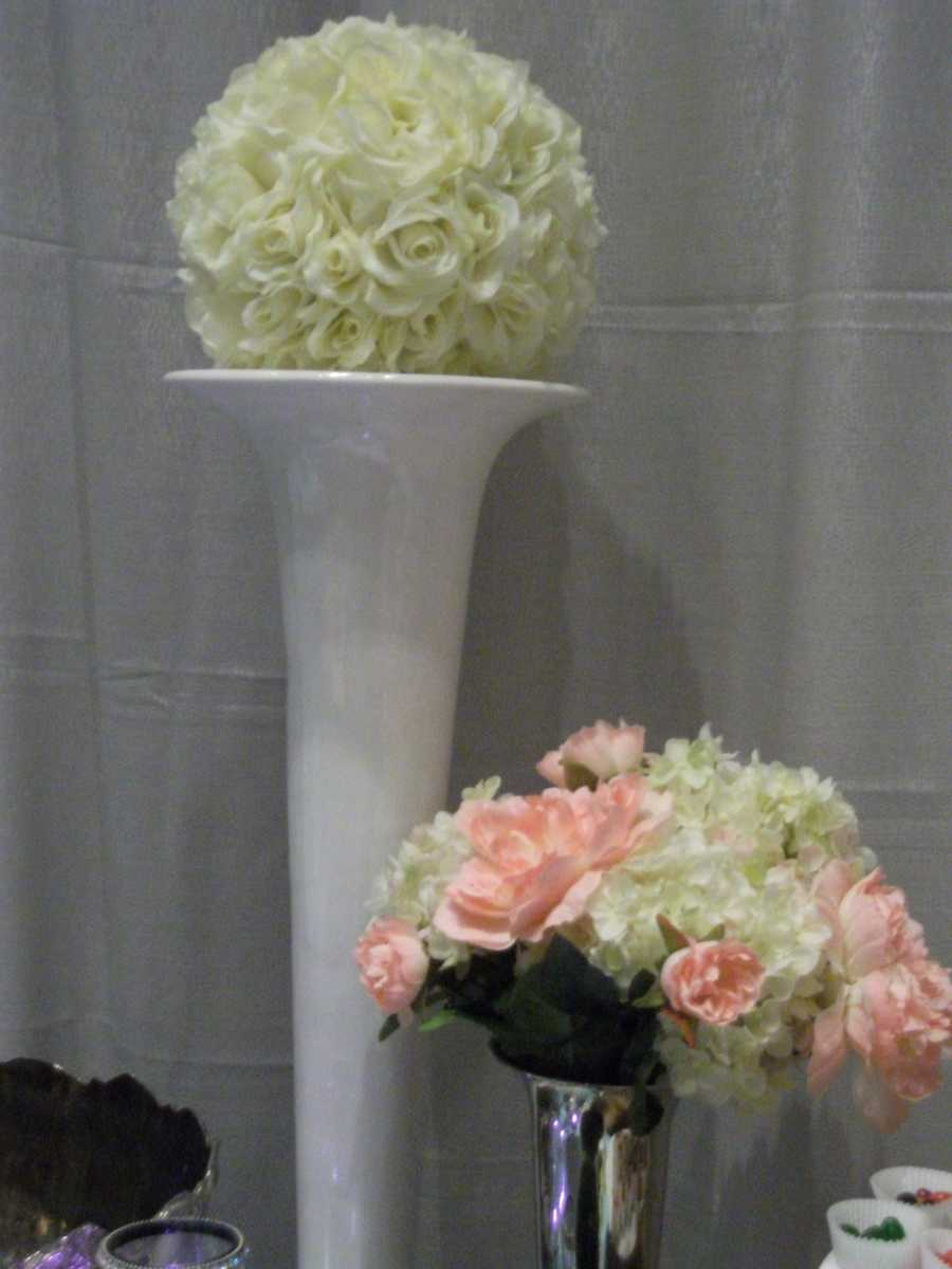 Flowers of different shapes and vases of different heights works well for the decor at the wedding and reception. (A&J Rental)
