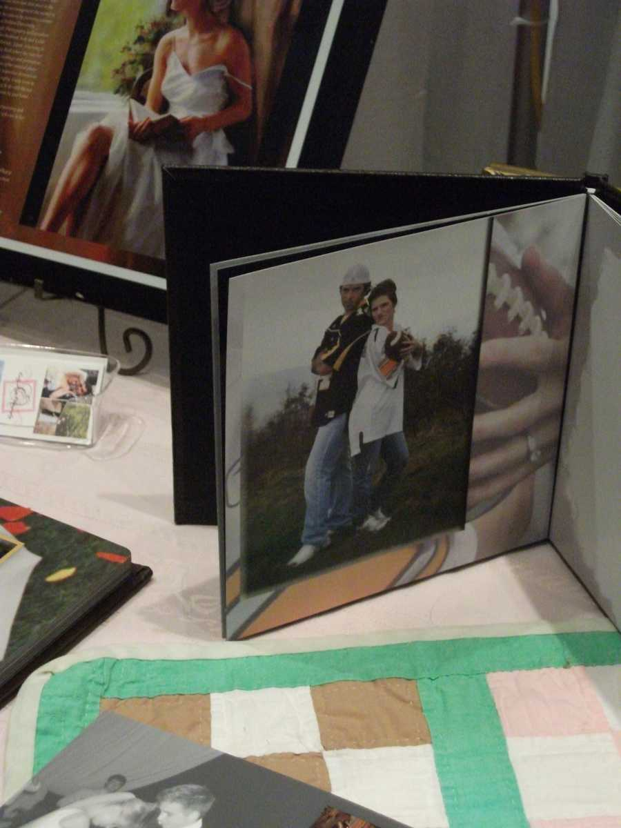 "Emily Angle Photography had a good representation of her photography work. ""Save The Date"" and wedding photos in her booth."