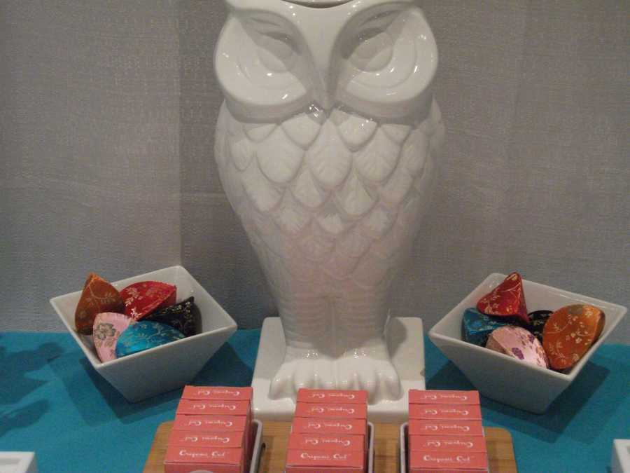 "Origami Owl had this owl setup that could work great as the ""seating name cards"" table with names on boxes with favors for the wedding guests. (Depending on the wedding budget)."