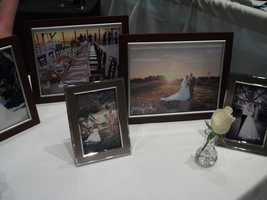 Elkin Creek Vineyard had many photos at their booth to show what has been done in past wedding receptions and areas for the wedding photo opportunities.