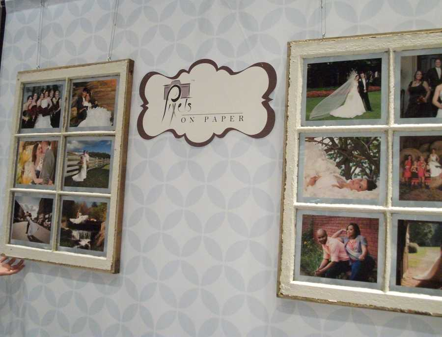 Pixels On Paper Photography and Graphic Design had some window panes with their photography work on their booth wall. This was a great way of seeing what types of styles they use.