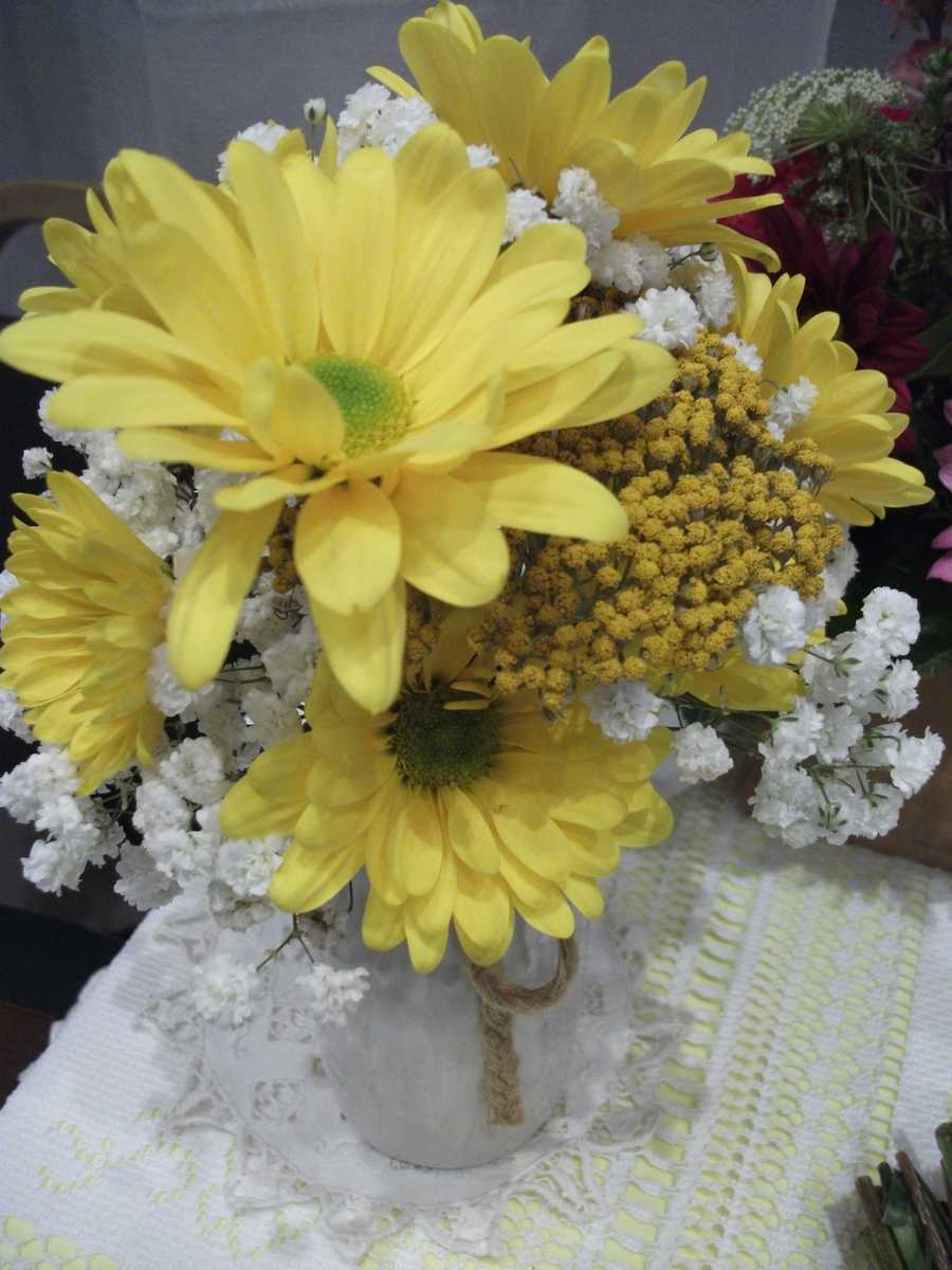These Spring/Summer/Easter Wedding Theme flowers would go great to decorate the reception tables.(Innovative Occasions)