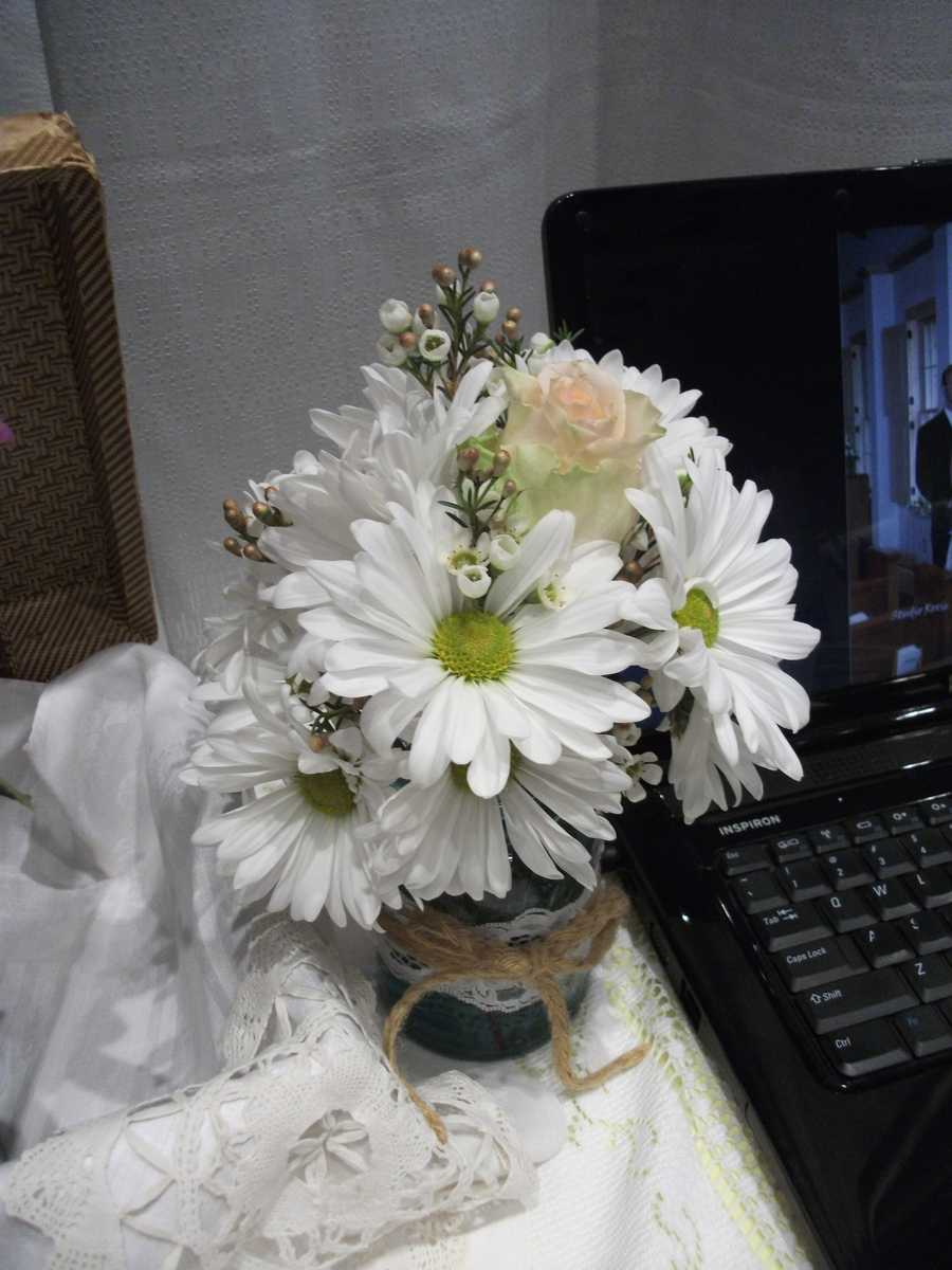 Innovative Occasions had this arrangement that could be used for a Spring/Easter or Country Western Themed Wedding.