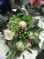 Innovative Occasions can design some beautiful bouquets or arrangements for the tabletops.