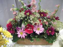 Innovative Occasions had these nice flower arrangements that could be used on the reception tables or the wedding parties long table. (Darker colors are more for fall/winter but can be used anytime)