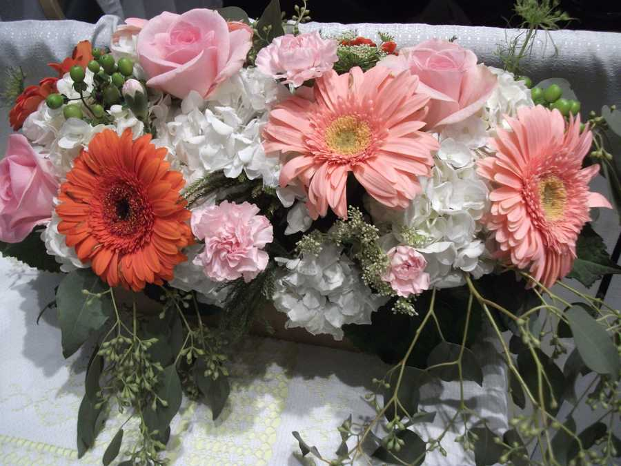 Innovative Occasions had this beautiful wedding box that shows orange and pinks as the wedding themes colors. (It is best to decide on wedding colors before going to vendors).