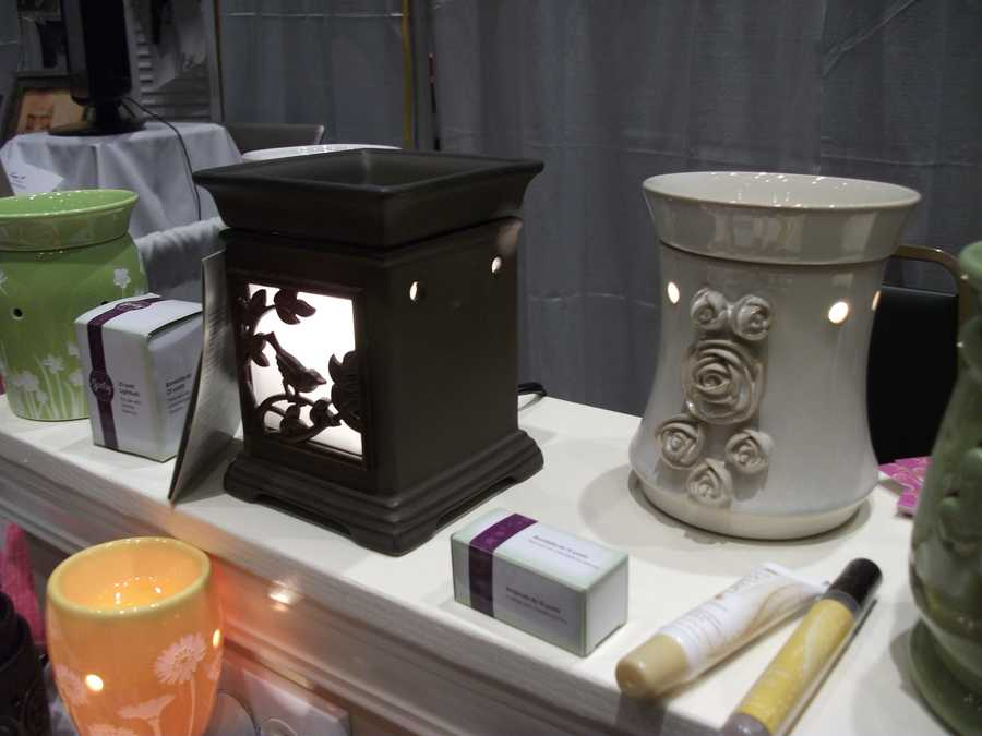 "Scentsy had some very unique scent warmers and maybe they could even be used on the reception tables. Watch for people with allergies before putting them on every table. Maybe the ""seating name card"" or couples photo and signing tables."