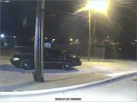 A Ford Crown Victoria, seen here in surveillance footage, was also involved in the ATM theft, police said.