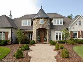 This seven bedroom estate is located in Greensboro and priced at $1,349,000. The home has an indoor heated pool and a mother-in law suite.
