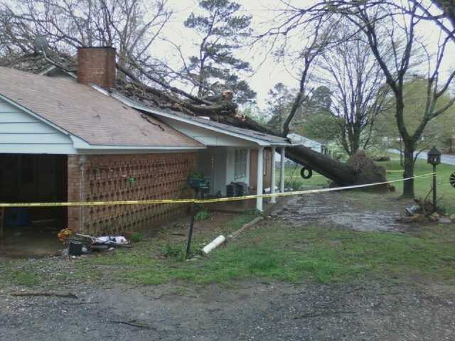 Tree down on a house on Little River Road in Seagrove. Photo by WXII's David Efird.