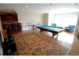 Game Room with one of three Bars located in the home