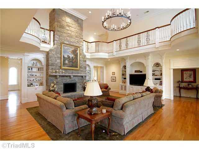 Two-Story Great Room with an upper gallery and juliet balconies at the four corners