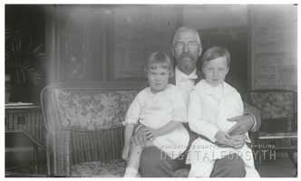 R. J. Reynolds holding his daughter Mary, and son Dick. The photo was taken on the porch of their West Fifth Street house.Courtesy of Forsyth County Public Library Photograph Collection.