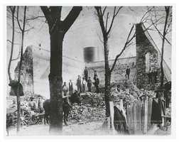 Collapse of Winston's water reservoir, 1904. Reservoir was located on Old Town Street (now named Trade Street), near Eighth Street. Photo shows the remaining walls and interior of the reservoir, and the standpipe in the background.Courtesy of Forsyth County Public Library Photograph Collection.