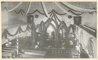 Home Moravian Church interior decorated for their 100th anniversary, 1900.Courtesy of Forsyth County Public Library Photograph Collection.