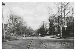 View looking east on W. Fourth Street, from Broad Street. There is a streetcar in the distance. Brown Memorial Church can be seen at right.Courtesy of Forsyth County Public Library Photograph Collection.