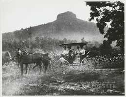 Buggy ride with Pilot Mountain in the distance. Walter and Blanche Thomas Sumner Hege are in the front seat. The couple in the back seat are unidentified.Courtesy of Forsyth County Public Library Photograph Collection.