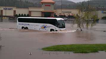 A bus tries to make its way through the Boone Mall parking lot.