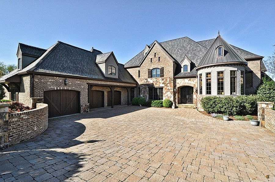 This Waxhaw estate is located on the 15th fairway of a Jack Nicklaus Signature country club community. The four bedroom home is priced at $2,499,900.