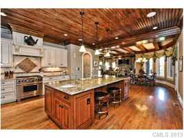 Gourmet Kitchen with hardwood floors and ceiling