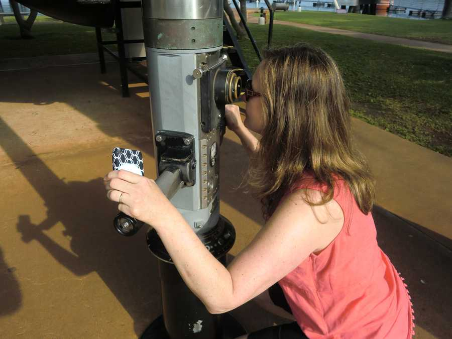 Angela Caviness trying out a periscope at the USS Bowfin Submarine Museum.