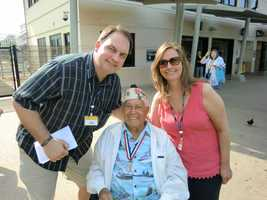 Austin and Angela pose with a living Pearl Harbor Survivor who told them his veteran story of that fateful day.