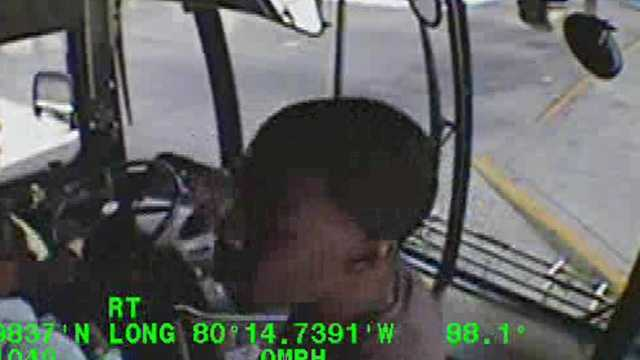Surveillance image of robbery suspect getting on city bus