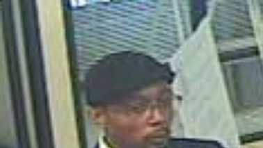 Surveillance image of suspect at State Employees Credit Union