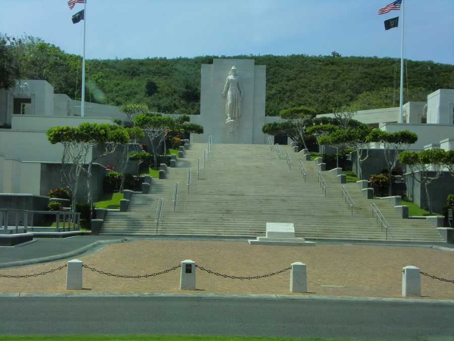 """The National Memorial Cemetery of The Pacific walls of the memorial are etched with names of 28,788 military personnel who are missing in action or were lost or buried at sea in the Pacific flank the Memorial's grand stair case. The slabs with the names are called the """"Courts of Missing."""""""
