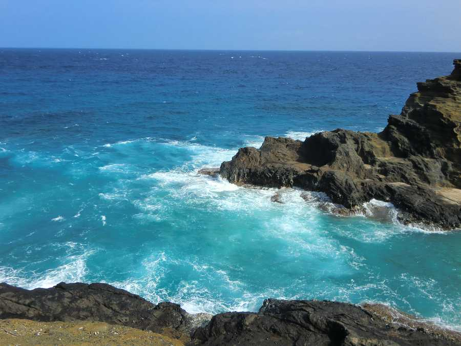 Beautiful ocean and secluded Halona Cove Beach for couples to retreat.