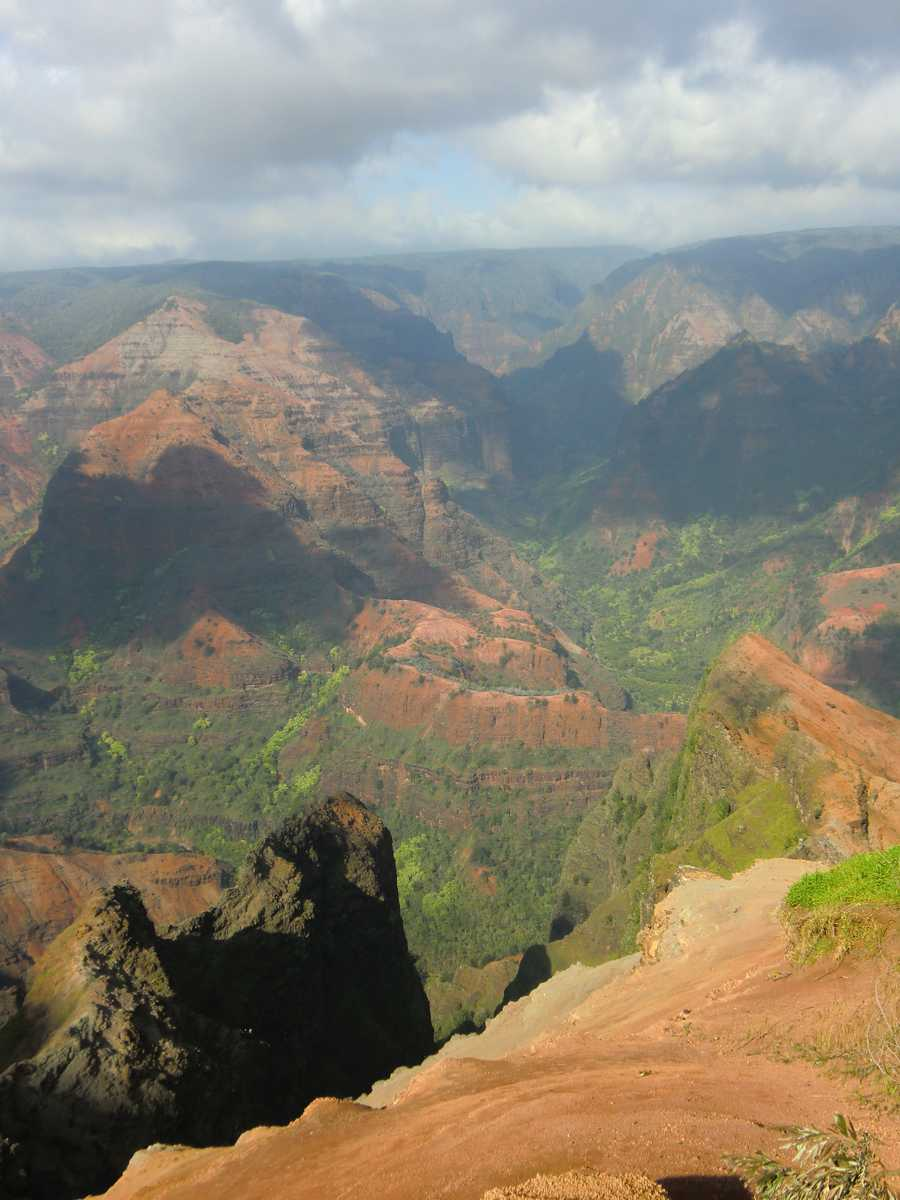 """Approximately ten miles long and up to 3,000 feet deep. Waimea means""""reddish water"""", in Hawaiian and references the erosion of the canyon's red soil."""