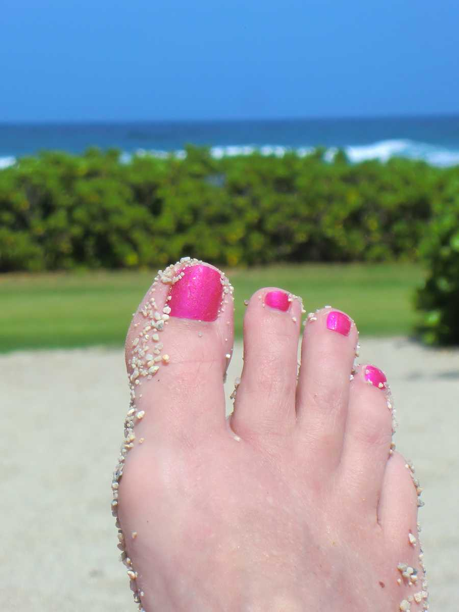 Cool pic of the pink toes and sand. Angela in total relaxation mode.