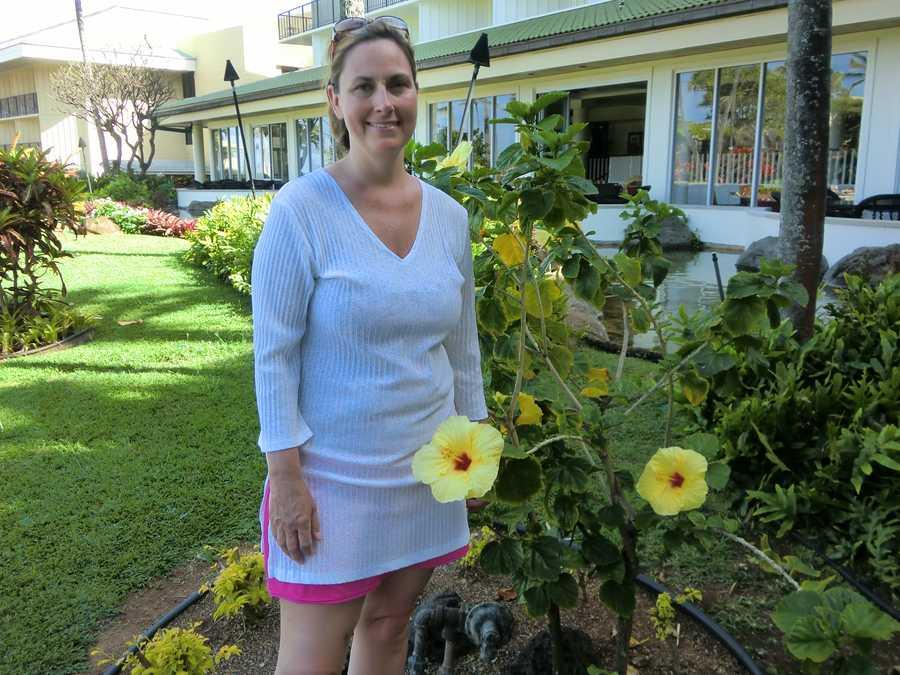 Angela poses for AC beside some beautiful Hawaiian flowers.