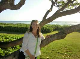Angela enjoying the beautiful morning and cool Hawaiian trees.