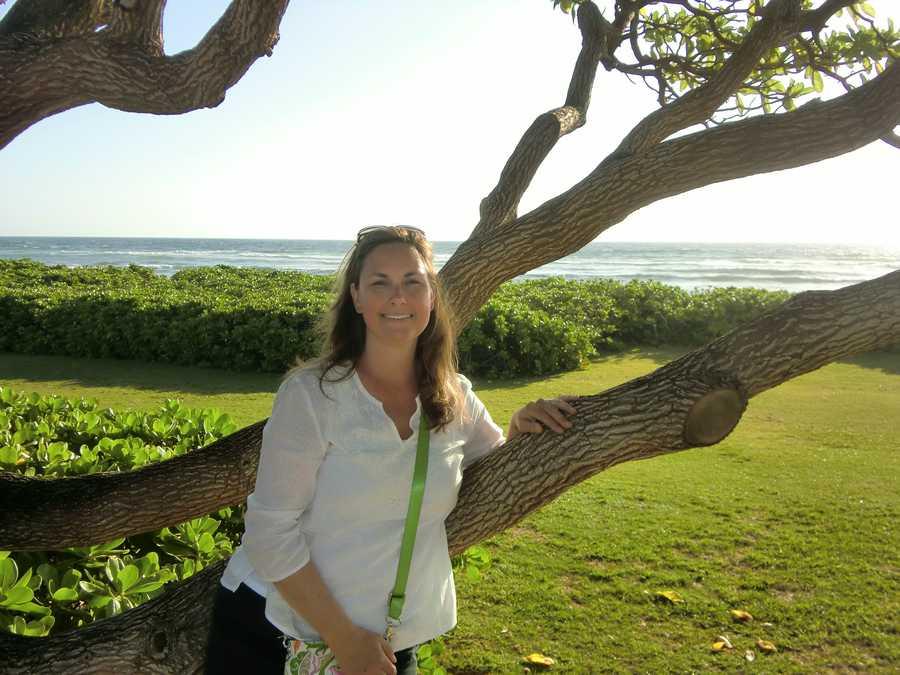 Angela enjoying the beautiful morning and cool Hawaiian trees.