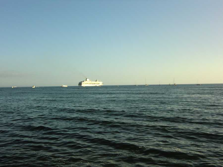 Angela spots a cruise ship in the distance, a great way to travel around the islands in Hawaii.