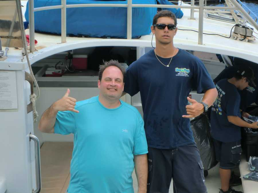 Austin and one of the deckhands from the Boss Frog's boat.