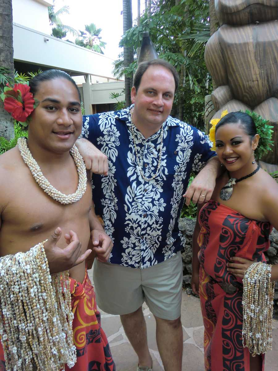 The entertainers at the Luau in Maui pose with Austin for some memorable pics.