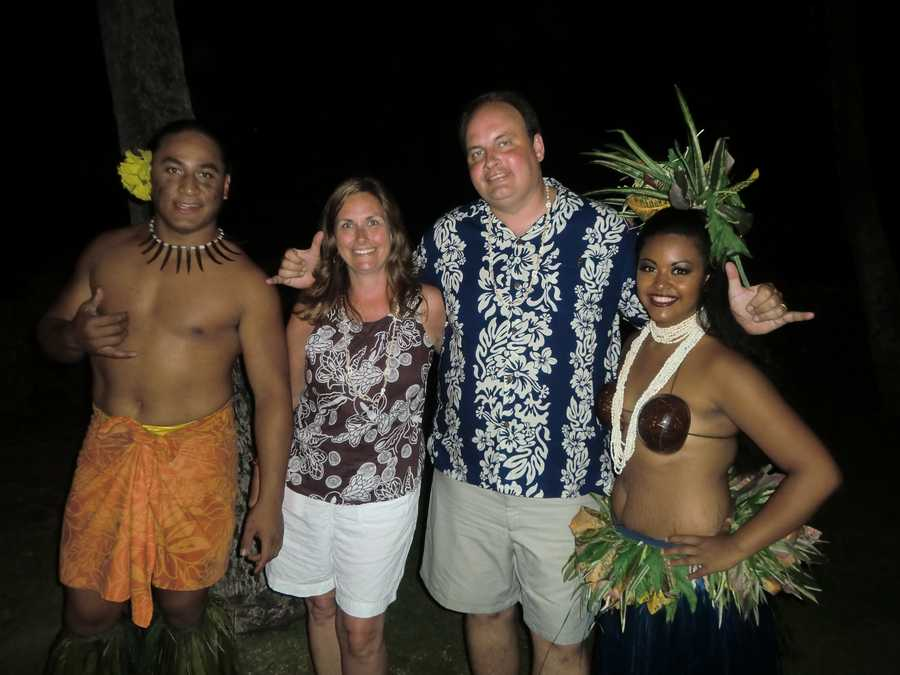 Austin is hanging ten with the male dancer, while Angela and the female dancer from the Luau pose for a photo.