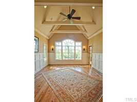 First Floor Master Bedroom with cathedral ceiling and a private patio