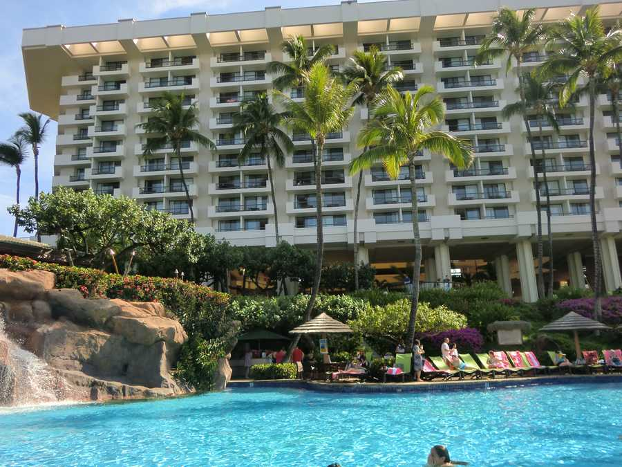 The Maui hotel looking up from the swimming pool. Those palm trees and water make anyone want to visit Hawaii.