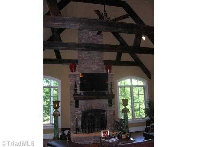 Family/Keeping Room with vaulted ceiling and a floor to ceiling stone fireplace