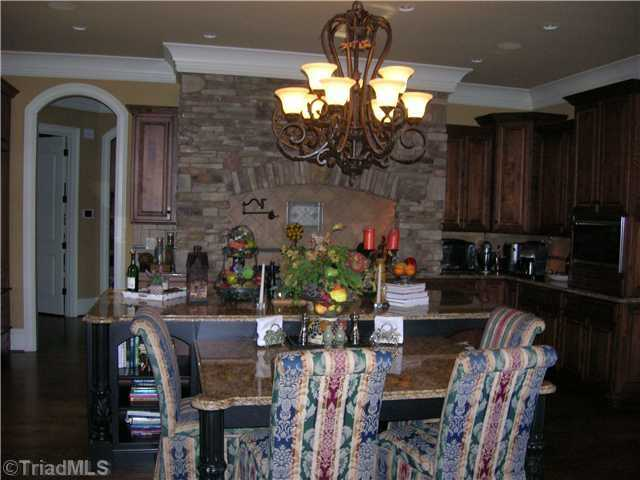 This Chef's Kitchen has an arched stone surround over the six gas burner range. The kitchen also has 2 sub zero refrigerators.