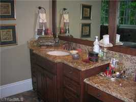 The Master Suite includes his/her closets and a his/her master bath
