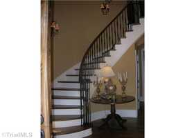 Foyer features a circular wooded staircase