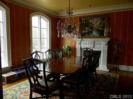 Formal Dining Room with a fireplace
