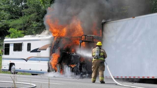 Firefighters carefully attacked a motor home fire on Interstate 77 due to racing fuel in the adjacent trailer.