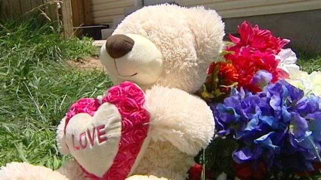 This teddy bear marks the spot where the teen was found dead.