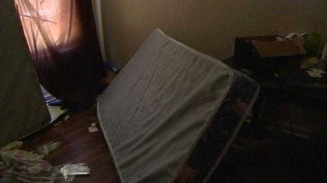Mattresses were up against a window in one bedroom, possibly being used as a shield.